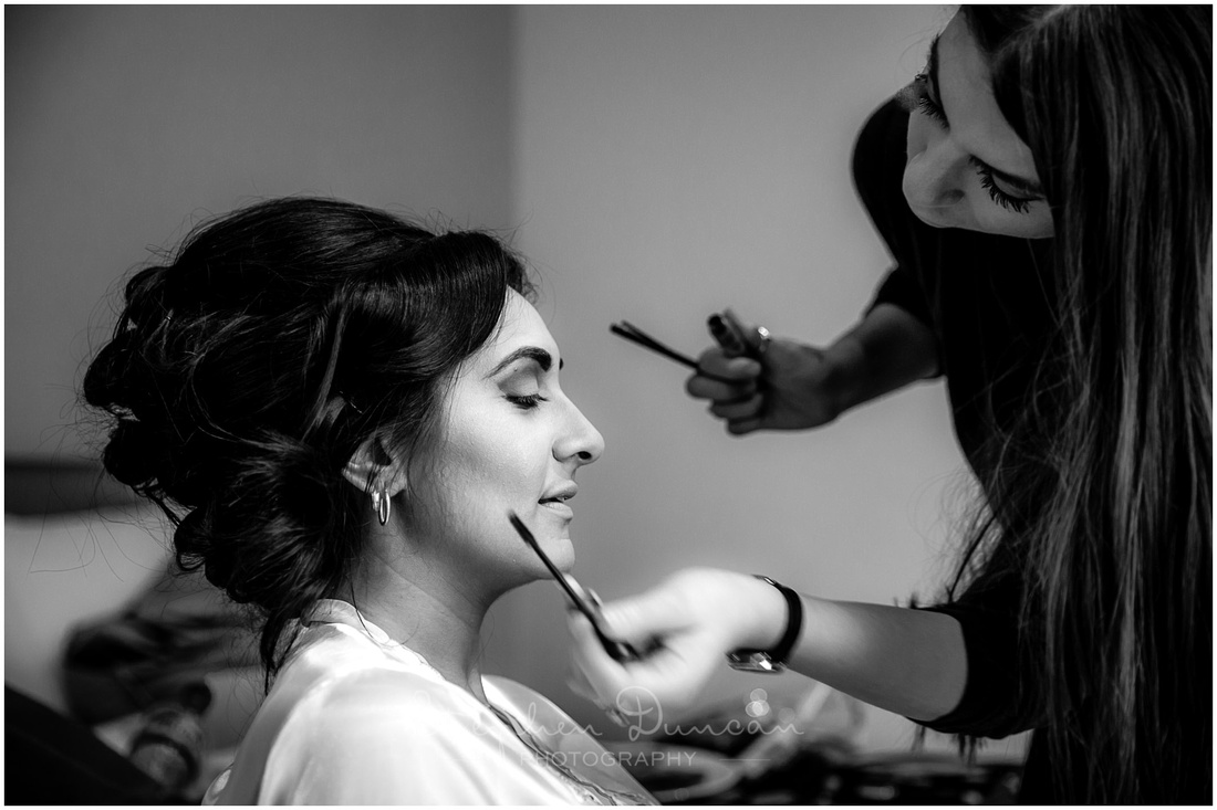 Make-up applied to bride during morning preparations