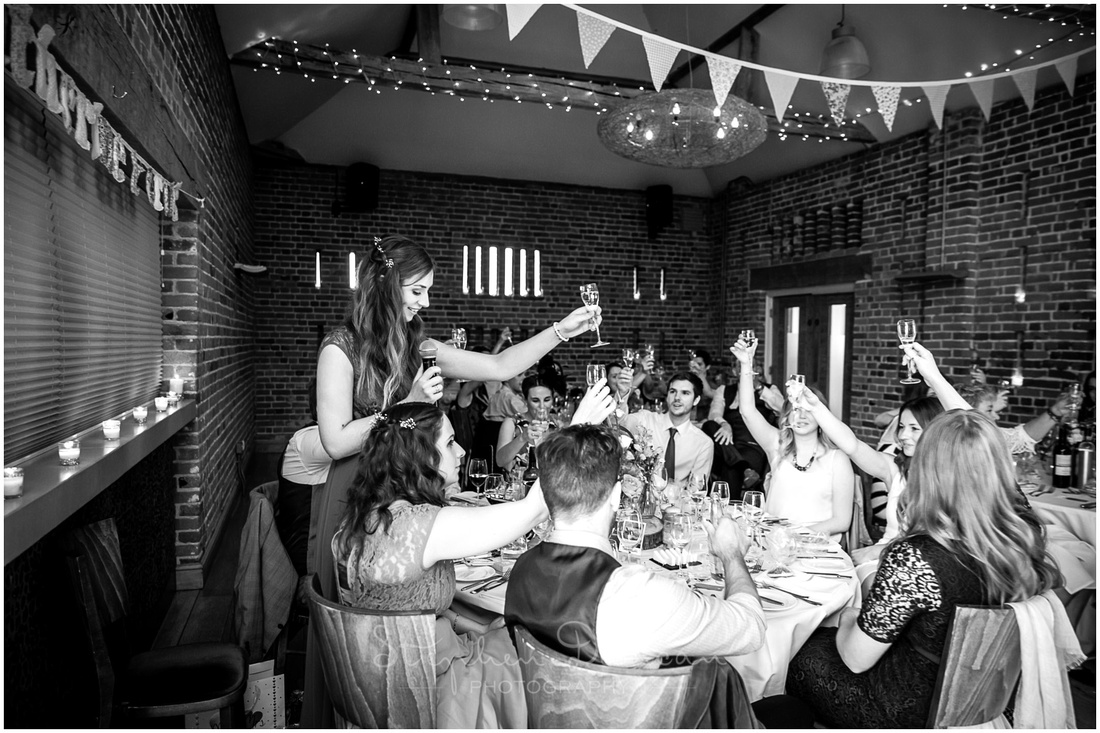 A bridesmaid leads a toast before the start of the wedding breakfast