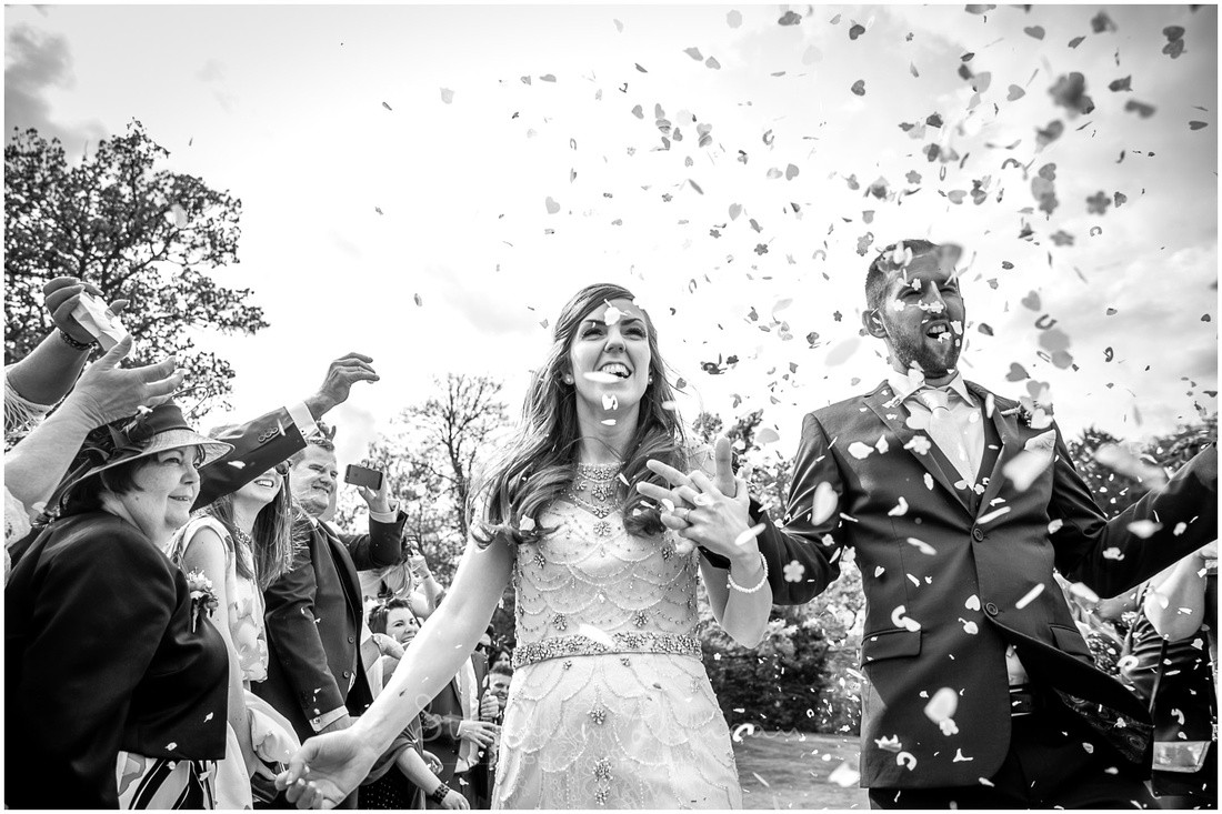 Close image of couple during the confetti throwing