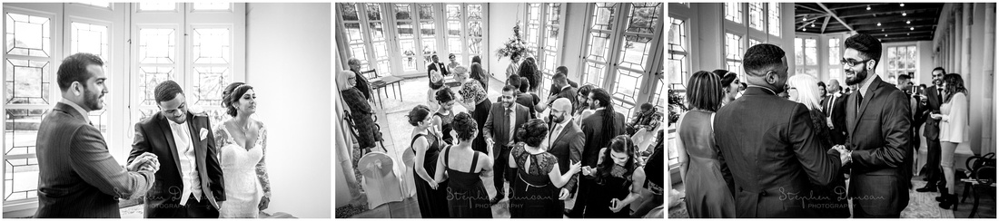 Guests approach the newly married couple to congratulate them at the end of the ceremony