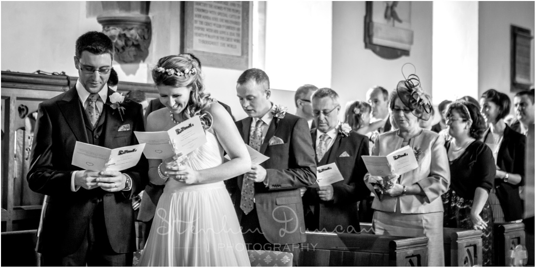 The bride and groom laugh together during the ceremony