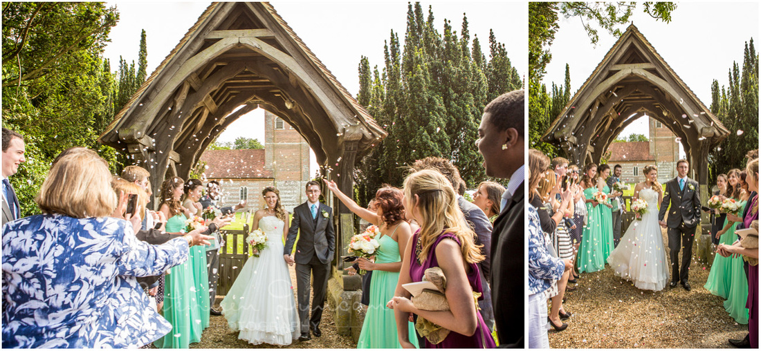 Confetti is thrown as the bride and groom exit by the church gate to head to the reception