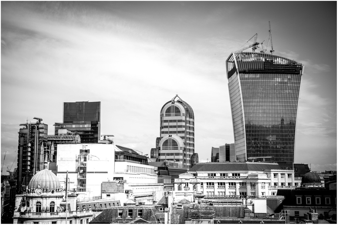 The 'walkie talkie' tower dominates the skyline, nestled amongst the other buildings of the financial quarter in the city
