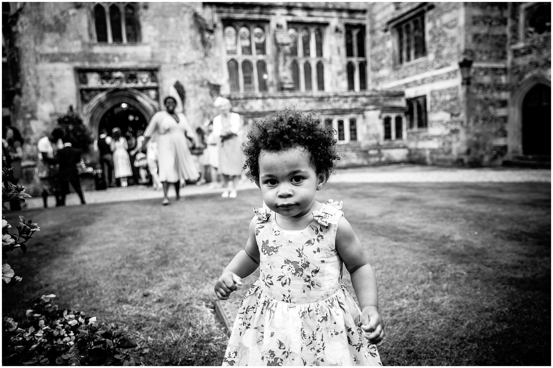 The bride and groom's daughter plays in the quadrant