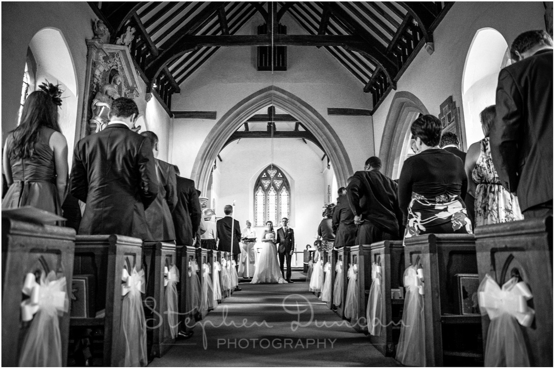 The bride and groom turn to face the congregation before making their vows