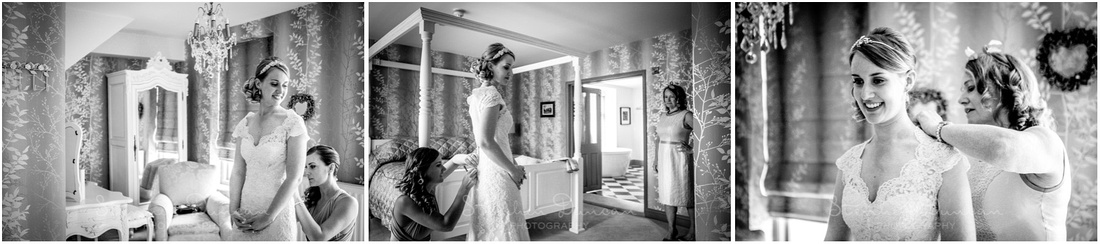 In the bridal suite, the bride gets into her dress and puts on her jewellery
