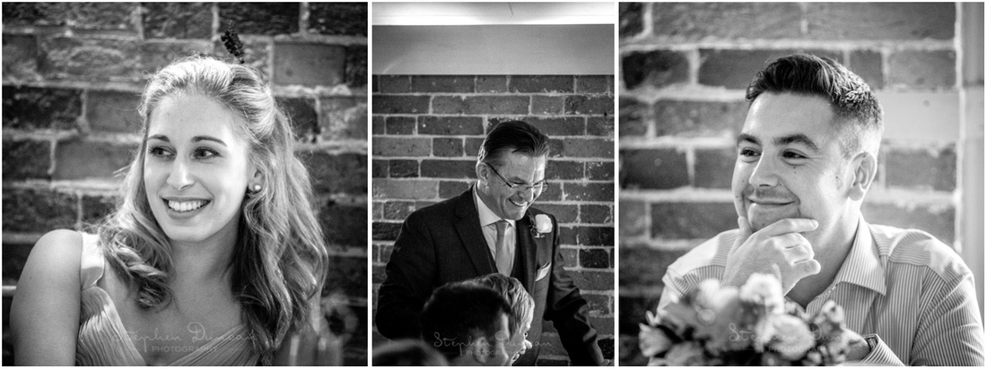 Wedding guests at Sopley Mill smiling during the speeches