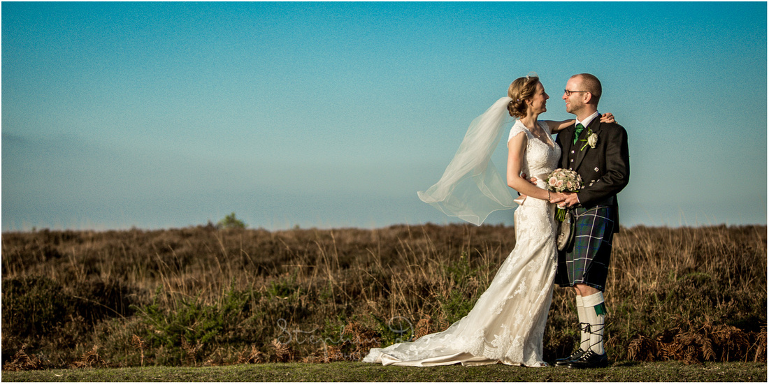 Bride and groom on New Forest heathland