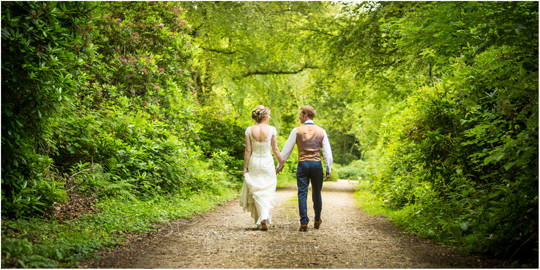 Wedding in the Woods Walking hand-in-hand down a country lane into the forest