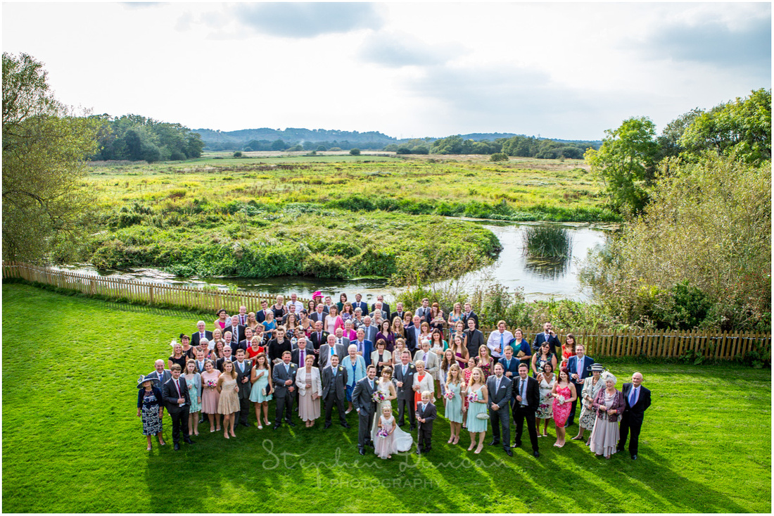 Photo of wedding guests with river Azon and countryside in the background