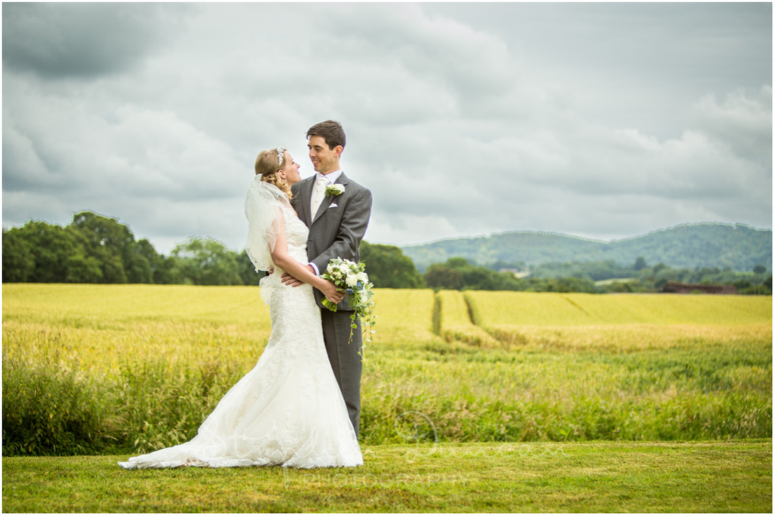 Bride and groom in front of South Downs National park landscape