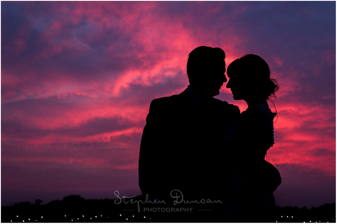 Bride and groom sunset silhouette at Sopley Mill Dorset