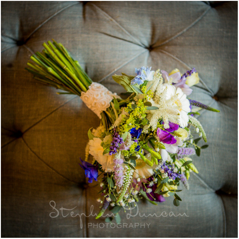 Wedding in the Woods Colour photo of summer bouquet on a banquette, shot in natural light
