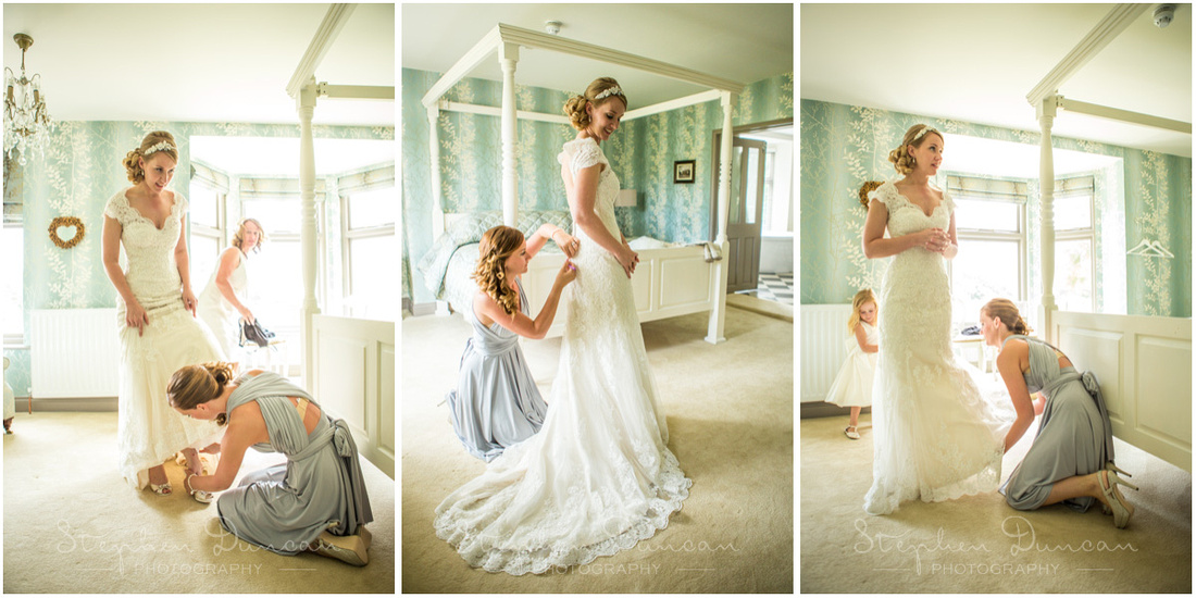 Bride and bridesmaid in the bridal suite of the hotel