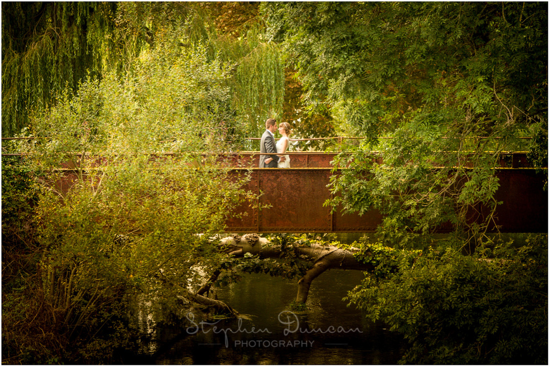 Colour photo of couple on bridge