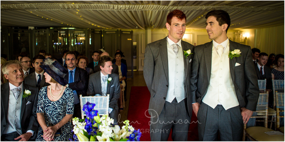 Southdowns Wedding Photography The groom and best man wait at the front of the ceremony room