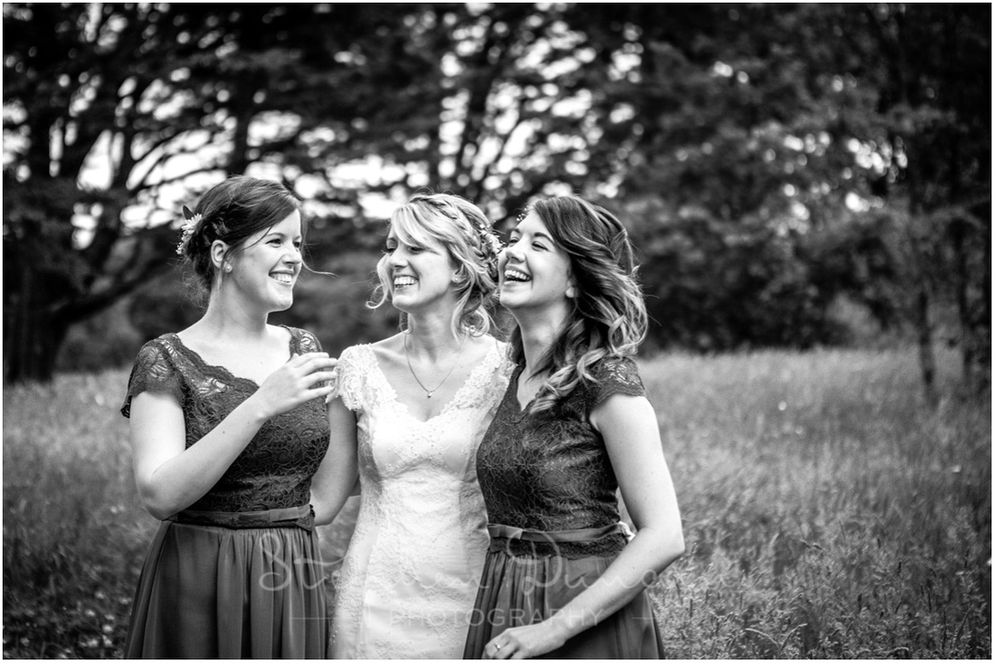 Wedding in the Woods A quick natural portrait of the bride and bridesmaids together before they leave for the wedding