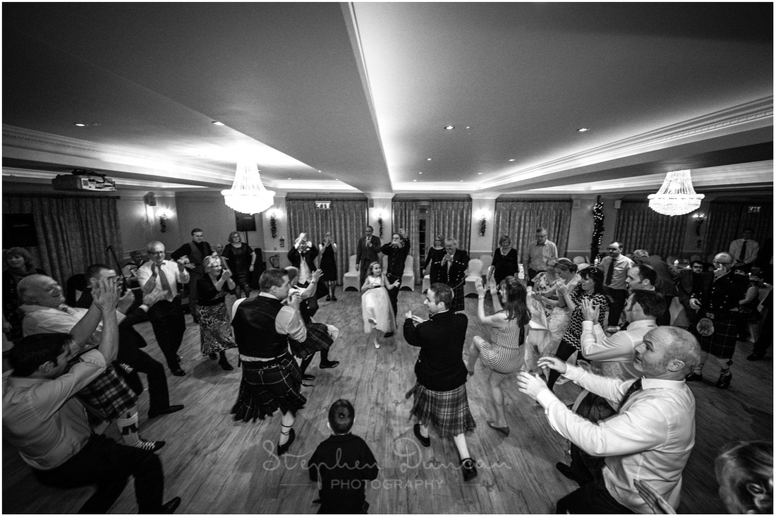 Wedding guests starting to get the hang of traditional scottish dancing