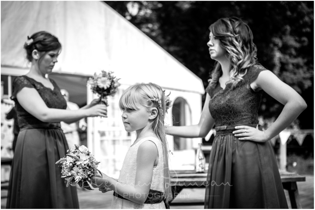 Wedding in the Woods Bridemaids and flower girl having a final check before their big moment