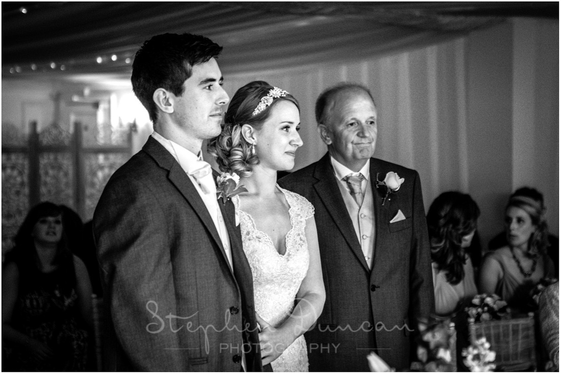 Southdowns Wedding Photography Bride, groom and father during the wedding ceremony