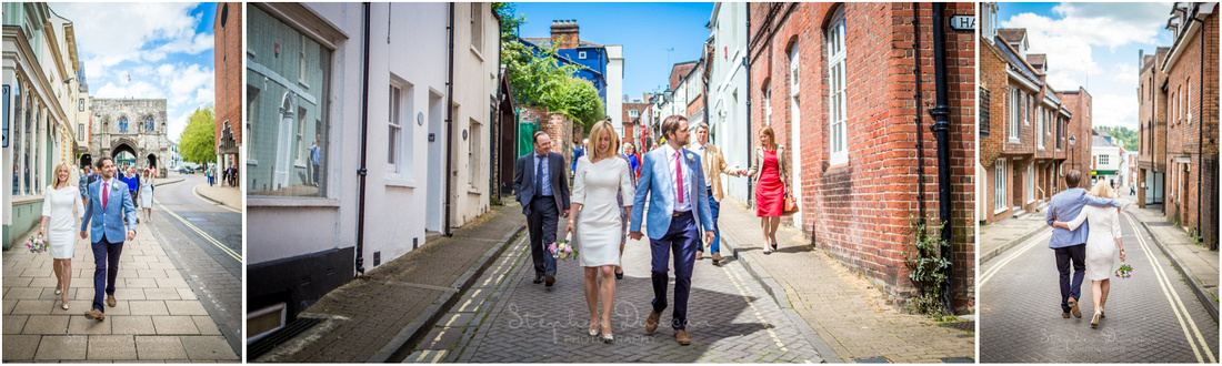 The bride and groom lead the small procession through the back streets of the city towards the Cathedral
