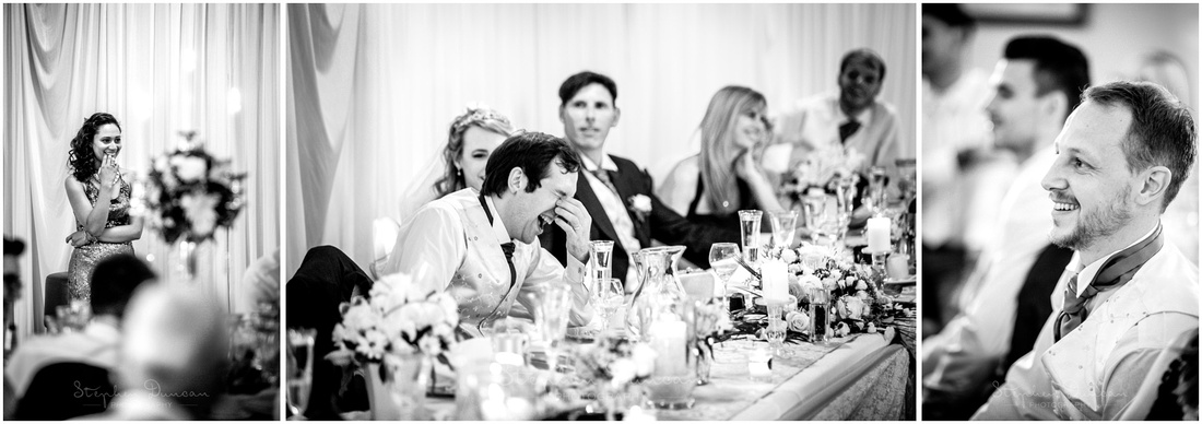 Wedding guests watch on as the groom laughs during the speeches
