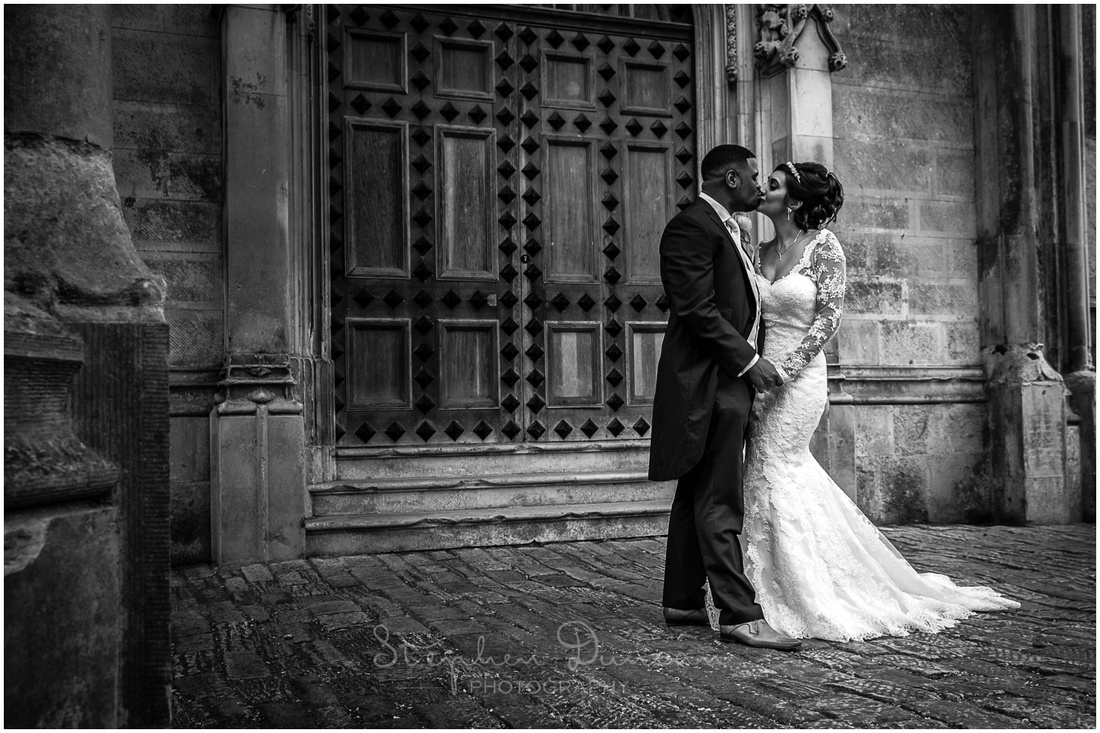 The couple kiss in front of the grand entrance to the Castle