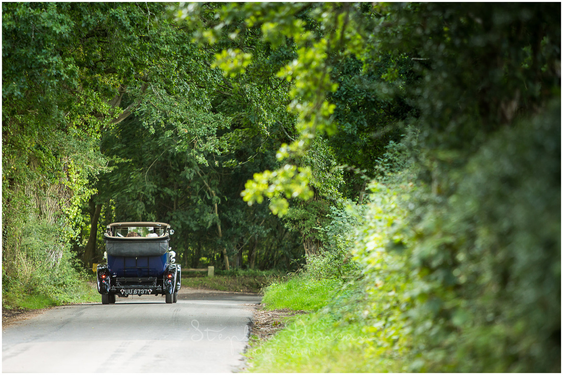 The wedding car leaves down the country lanes, heading for the reception