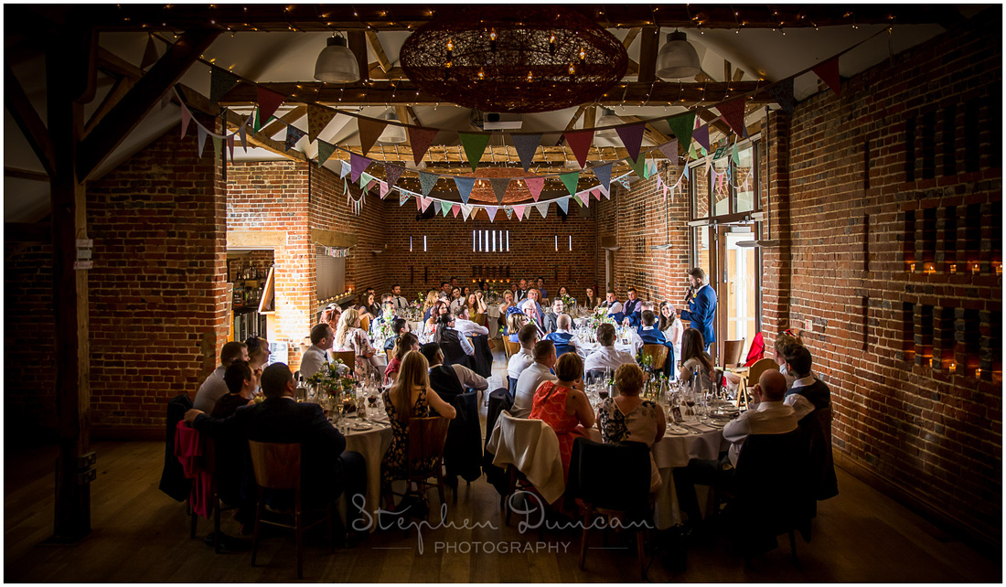 Full-length image of the barn used for the wedding breakfast at Wasing Park