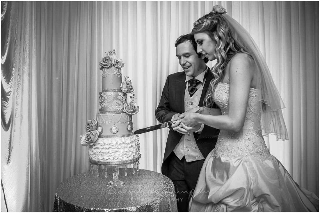 Bride and groom cut the wedding cake at the start of the evening's celebrations