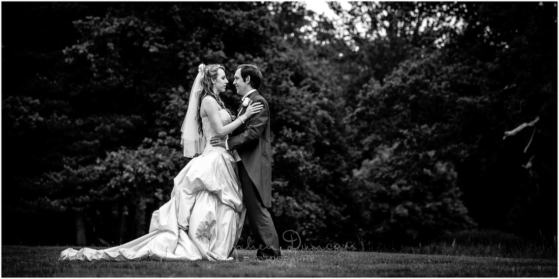 Portrait of bride and groom in hotel grounds