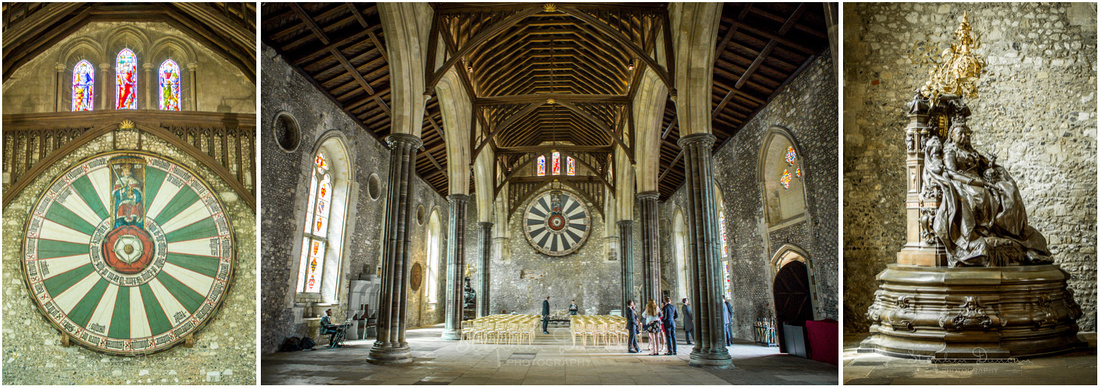 The Round Table hangs on the wall at the far end of the Hall, underneath beautiful stained-glass windows.