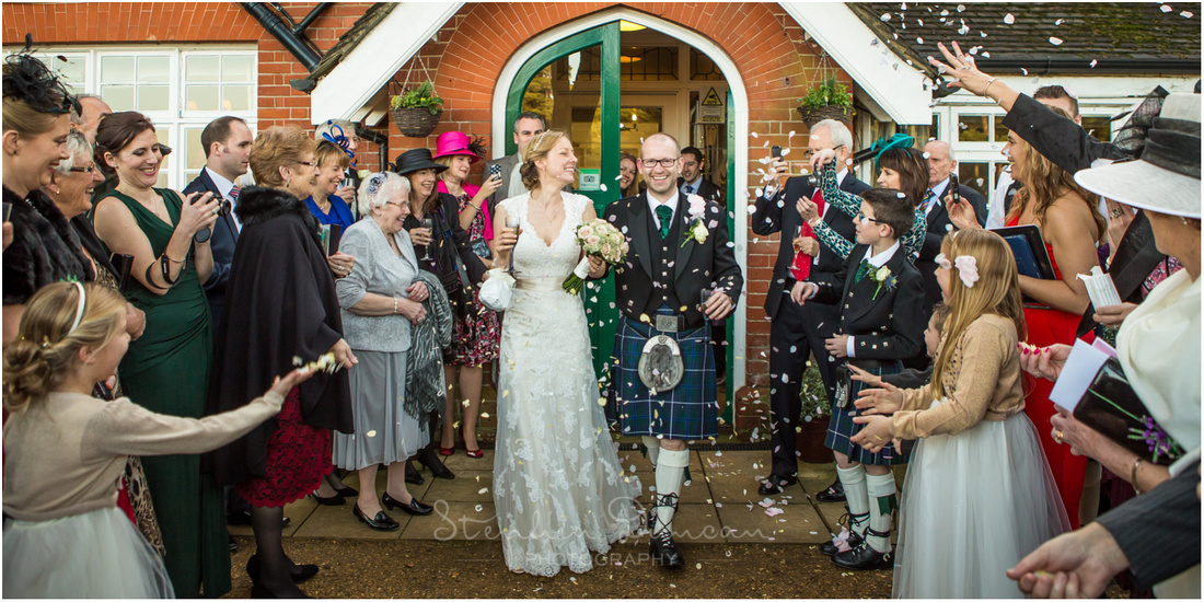 Bride and groom greeted with confetti at wedding reception