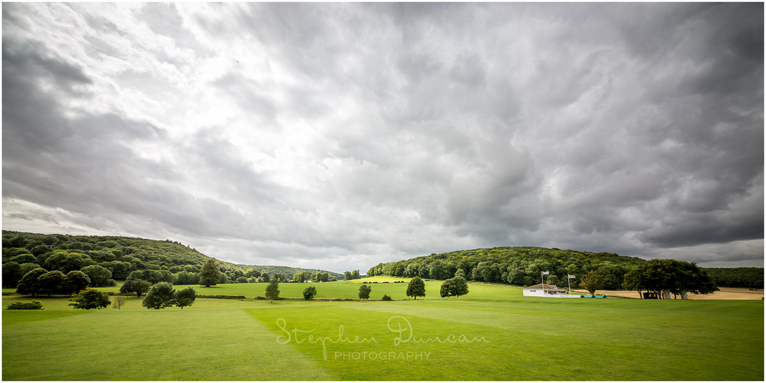 Clouds roll in over the cricket fields