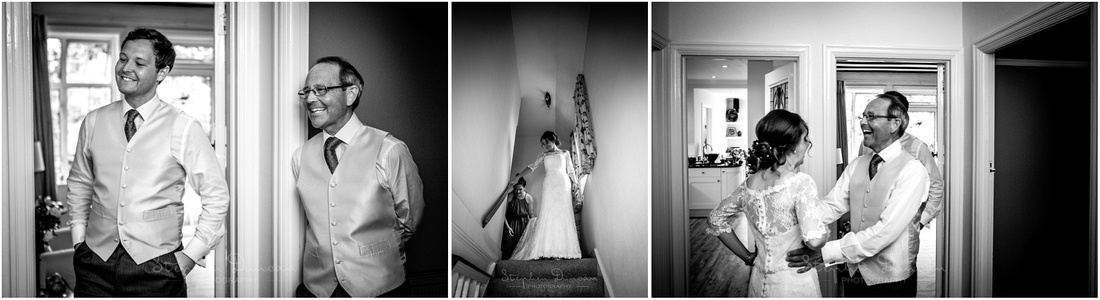 The bride comes down the stairs in her wedding dress to meet her father and brother