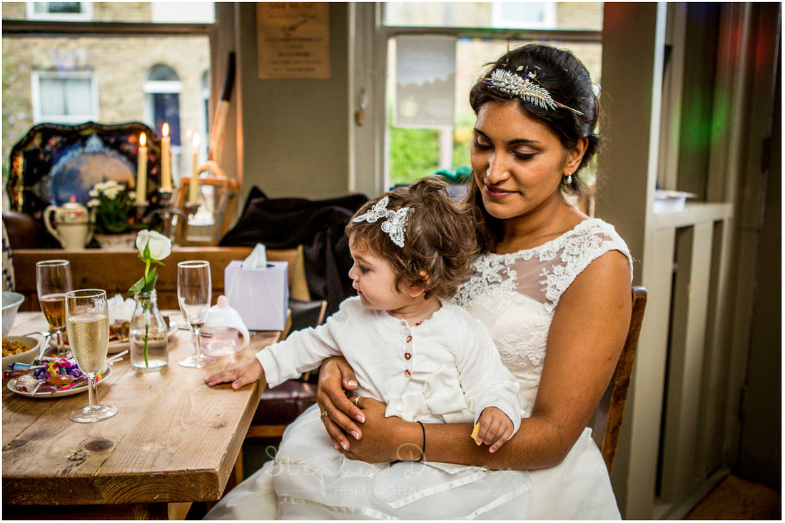 The bride and her daughter enjoy a moment together at the wedding reception