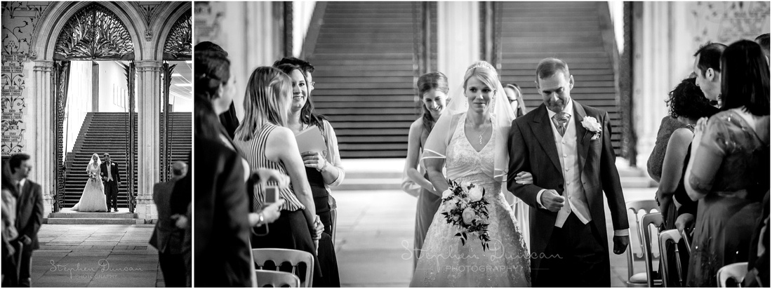 The bride arrives through the huge iron gates at the far end of the hall before walking down the aisle with her father