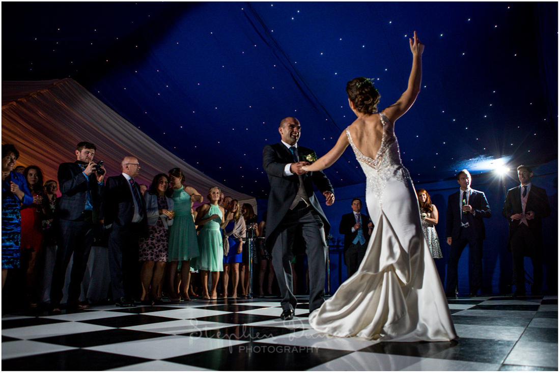 Bride and groom's first dance during marquee reception in grounds of Dulwich Picture Gallery